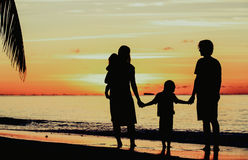 Happy family with two kids on sunset beach Royalty Free Stock Images