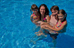 Happy family with  two kids in swimming pool Royalty Free Stock Photography