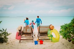 Happy family with two kids on beach vacation. Happy family with two kids on tropical beach vacation Royalty Free Stock Images