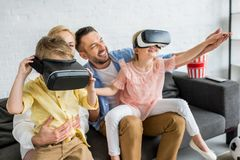 happy family with two kids using virtual reality headsets royalty free stock image
