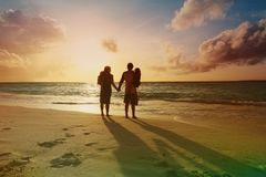 Happy family with two kids walk on sunset beach. Happy family with two kids walk on sunset tropical beach Stock Photos
