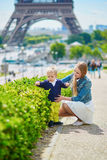 Happy family of two in Paris near the Eiffel tower Royalty Free Stock Photo