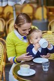 Happy family of two in Parisian cafe Royalty Free Stock Photography