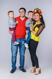 Happy family with two small boys in autumn family look Royalty Free Stock Images