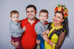 Happy family with two small boys in autumn family look Royalty Free Stock Photo