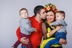 Happy family with two small boys in autumn family look Stock Image
