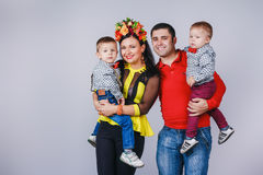 Happy family with two small boys in autumn family look Royalty Free Stock Image
