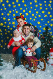 The happy family with two small boys Royalty Free Stock Photo