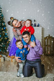 The happy family with two small boys Royalty Free Stock Photos