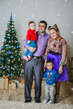 The happy family with two small boys Stock Images