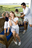 Happy family with two teenagers on terrace stock image