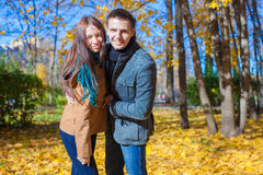 Happy family of two walking in autumn park on a Stock Photography