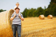 Happy family of two: Young father and his little son having fun Royalty Free Stock Photography