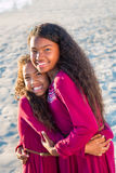 Happy family, two young sisters portrait outdoors smiling. Royalty Free Stock Photo