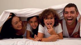 Happy family under the blanket stock video