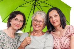 Happy family under green umbrella Stock Photos