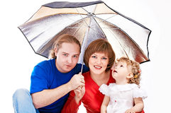 Happy family under umbrella Royalty Free Stock Image