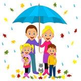Happy family under umbrella. Stock Image
