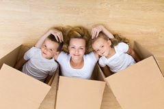 Happy family unpacking Royalty Free Stock Photos
