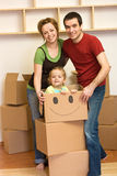 Happy family unpacking in a new home Stock Photography
