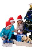 Happy family unwraping christmas gifts. Near christmas tree Stock Photography