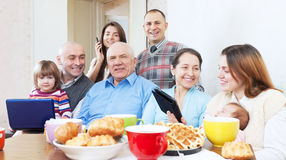 Happy family  uses electronic devices Stock Photography
