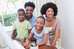 Happy family using the computer Royalty Free Stock Photos