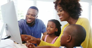 Happy family using desktop computer. At home stock footage