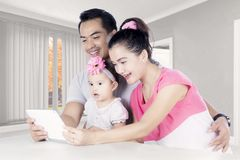 Happy family using a digital tablet at home Stock Photos