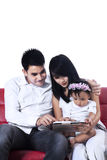 Happy family using a digital tablet Royalty Free Stock Photos