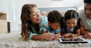 Happy family using digital tablet in living room. At home stock footage