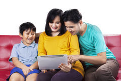 Happy family using digital tablet Royalty Free Stock Photos