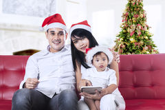 Happy family using digital tablet Royalty Free Stock Images