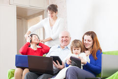 Happy  family using few portable computers Stock Images
