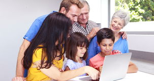 Happy family using a laptop. At home stock footage
