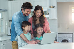 Happy family using laptop. At home Stock Photography
