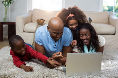 Happy family using laptop. At home Stock Image