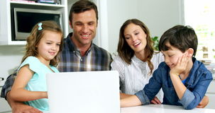 Happy family using laptop. At home stock footage
