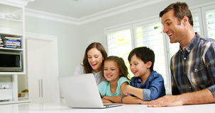 Happy family using laptop. At home stock video