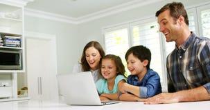 Happy family using laptop stock video