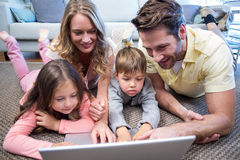 Happy family using the laptop. At home in the living room Royalty Free Stock Images