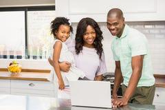 Happy family using laptop Royalty Free Stock Photography