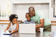 Happy family using laptop Stock Photo
