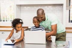 Happy family using laptop Stock Photo