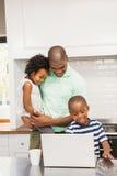 Happy family using laptop Stock Photos
