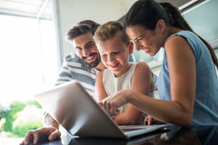 Happy family using laptop in the living room Royalty Free Stock Photography