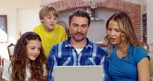 Happy family using laptop. On the sofa stock video