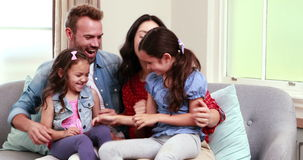 Happy family using laptop on sofa. At home stock footage