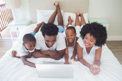 Happy family using the laptop together Stock Photo