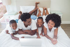 Happy family using the laptop together Royalty Free Stock Photography